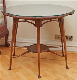 Sale 9098H - Lot 38 - An elegant Edwardian mahogany shaped top centre table with lower shelf and slender cabriole leg support, Height 74cm x Diameter 89cm