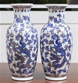 Sale 9140H - Lot 5 - A pair of Chinese dragon themed baluster vases with blue and gilt dragon amongst clouds on white ground, Height 31cm