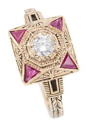 Sale 9083 - Lot 513 - A DECO STYLE 9CT GOLD RUBY AND DIAMOND RING; 10mm square top centring an elevated round brilliant cut diamond of approx. 0.25ct, to...