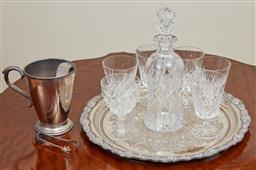 Sale 9098H - Lot 39 - A silver plated engraved tray with fruiting vine border carrying a cut crystal decanter, five footed glasses and one other plus an i...