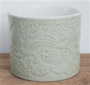 Sale 8530A - Lot 260 - A Qing style celadon brush pot, decorated with dragons and floral, Kangxi mark to the base, H 16cm