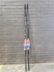 Sale 8962 - Lot 1006 - Pair of Vintage Nordic Cross Country Skis with Fitted Shoes (L:207cm)