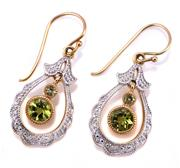 Sale 9095 - Lot 386 - A PAIR OF 9CT GOLD PERIDOT AND DIAMOND EARRINGS; elongated drops each with 2 articulating peridots on a shepherds hook, length 26mm,...