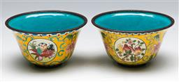Sale 9144 - Lot 152 - A pair of enamelled Chinese cups featuring flowers and children (dia 9cm)