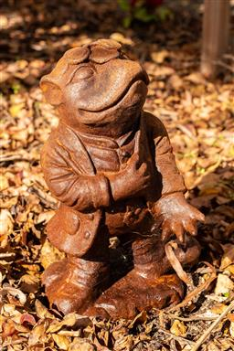 Sale 9191W - Lot 450 - A cast iron statue  of Mr Toad From wind in the Willows