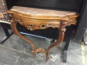 Sale 8839 - Lot 1303 - Heavily Carved Consol Table