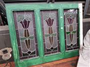 Sale 8925 - Lot 1047 - A green painted timber and stained glass window (72.5 x 93cm)