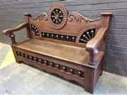 Sale 9014 - Lot 1038 - Early 20th Century Breton Oak Bench, with turned spindle galleries & ornaments to back & seat, the seat with a hinged lid (H:118 W:1...