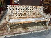 Sale 8693 - Lot 1003 - Late Victorian Coalbrookdale Cast Iron Garden Bench After a Design by Christopher Dresser, in distressed white paint and partially v...