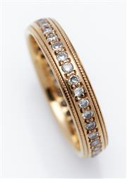 Sale 9080J - Lot 59 - An 18ct yellow gold eternity ring set with a continuous band of 36 diamonds