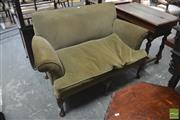 Sale 8291 - Lot 1063 - Georgian Style Small Settee, with rolled arms upholstered in green corduroy, on shell carved cabriole legs