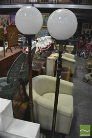 Sale 8312 - Lot 1092 - Two Timber Standard Lamps with Ball Shades