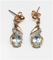 Sale 8550F - Lot 242 - A pair of 9 ct gold stud earrings with a topaz and three small single cut diamonds in each, stamped, drop length 20mm.