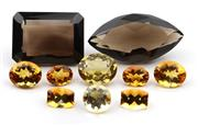 Sale 8790 - Lot 314 - A PARCEL OF UNSET SMOKY QUARTZ AND CITRINES; emerald cut 24.2ct, marquise cut 21.4ct, citrines total 15.36ct.