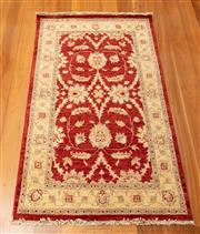Sale 8855H - Lot 12 - Cadrys Afghan Rug, 157 x 95cm, hand knotted wool, with russet and beige repeating floral pattern