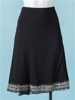 Sale 9092F - Lot 50 - A BLACK MESSINA MID LENGTH SKIRT; with embellishments to hem. Size 12
