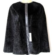 Sale 8196F - Lot 348 - A JANE POST VELVET AND LEATHER CAPE; retailed by Saks Fifth Avenue brand new with tag and reversible (XS).