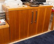 Sale 8741A - Lot 90 - A two door veneered entertainment cabinet with shelved interior, H x 70cm, W x 110cm, D x 63cm