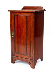 Sale 9044J - Lot 80 - An antique walnut single door bedside cabinet C: 1900. The shaped back with a step edged top above the reeded panel door opening to ...
