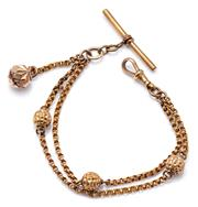 Sale 9083 - Lot 472 - A VINTAGE GOLD PLATED ALBERTINA BRACELET; 2 rows of belcher chain inserted with 3 faceted spheres attached with a swivel clasp, t ba...