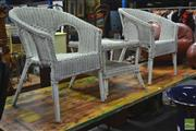 Sale 8299 - Lot 1036 - Three Piece Wicker Outdoor Setting