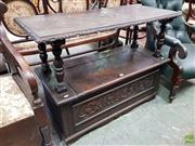Sale 8576 - Lot 1074 - Carved Oak Monks Bench, the carved top converting to back rest, on turned supports above a hinged seat & floral carved front