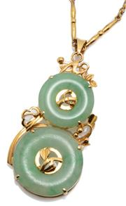 Sale 9046 - Lot 538 - A GOLD DOUBLE JADE BI PENDANT NECKLACE; featuring a 19mm and a 14.5mm green jade disc set in 14ct gold, length 40mm, wt. 5.3g, on an...