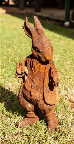 Sale 9191W - Lot 455 - A cast iron  statue of Bouncer rabbit  ((made into a pie by Mrs McGregor) H.46cm