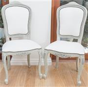 Sale 8471H - Lot 38 - A set of seven French style ivory linen upholstered grey painted dining chairs with stud detail on cabriole legs