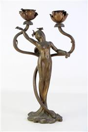 Sale 8905S - Lot 614 - An Art Noveau figural candle holder. Height 36cm