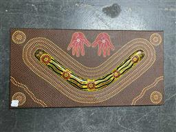 Sale 9176 - Lot 2045 - Col Cook Boomerang Dreaming, 2007 hand-painted boomerang mounted on canvas, 31 x 61cm, signed verso