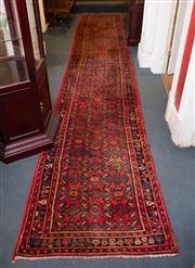 Sale 7962B - Lot 18 - Long Persian Runner with Red Ground