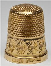 Sale 7988 - Lot 305 - A 15CT GOLD THIMBLE; guilloche and engraved pattern hallmarked Chester 1926. Wt. 6.2g.