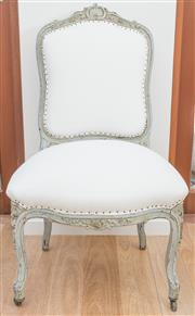 Sale 8471H - Lot 39 - A pair of French style ivory linen upholstered grey painted dining chairs with stud detail on cabriole legs and castors with shell c...