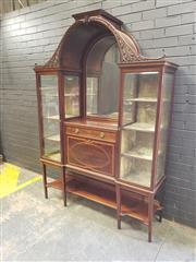 Sale 8993 - Lot 1090 - Unusual Edwardian Mahogany Display Cabinet, with central arch over a mirrored niche, surmounted by another low plinth, above a drawe...