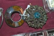 Sale 8087B - Lot 311 - TWO SILVER STONE SET BROOCHES; one inlaid with agates other with coloured resin.