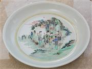 Sale 8530A - Lot 254 - A Qing period famille rose plate, decorated with figural, L 42cm