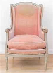 Sale 8471H - Lot 52 - A French wingback armchair upholstered in salmon pink velvet, with brass stud detail, on cabriole legs, H of back 110cm