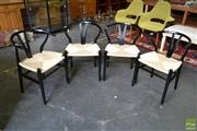 Sale 8532 - Lot 1389 - Set of Four Black Wishbone Chairs with Rush Seat