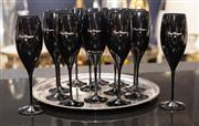 Sale 8709 - Lot 1061 - A set of thirteen black Dom Perignon champagne glasses together with another, on a silver plated tray marked Savoy