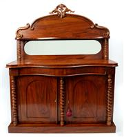 Sale 9044J - Lot 24 - An antique English walnut cabinet C: 1880. The crest carved and C scroll back mirrored and fitted with a shaped shelf raised on ba...