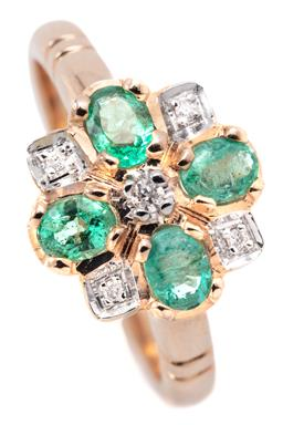 Sale 9132 - Lot 430 - A 9CT GOLD EMERALD AND DIAMOND CLUSTER RING; centring a round brilliant cut diamond to surround of 4 oval cut emeralds and a further...