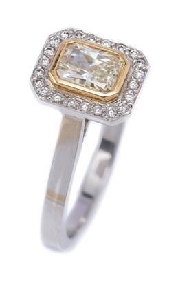 Sale 9191H - Lot 41 - AN 18CT WHITE GOLD DIAMOND CLUSTER RING; rub set in yellow gold with a fancy light yellow radiant cut diamond of 0.61ct VS2 to an oc...