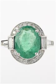Sale 8447J - Lot 49 - A PLATINUM EMERALD AND DIAMOND DRESS RING; claw set with an oval cut emerald of approx 4.33ct surrounded by 16 round brilliant cut d...