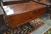 Sale 8335 - Lot 1048 - Regency Plum Pudding Mahogany Pembroke Table, with hinged leaves, octagonal pedestal & outswept feet