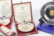 Sale 8586 - Lot 91 - Cased Royal Mint Sterling Silver Commemorative Plates, a Pewter & Gold Plate Example with a European Silver Spoon The Legend of the...