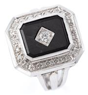 Sale 9095 - Lot 400 - A DECO STYLE DIAMOND AND ONYX RING; emerald shape top with elevated onyx plaque inset with a round brilliant cut diamond surrounded...