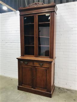 Sale 9097 - Lot 1007 - Late Victorian Walnut Bookcase, with two glass panel doors, above two drawers and two panel doors (2 keys in the office)