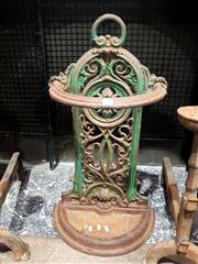 Sale 8693 - Lot 1044 - Victorian Cast Iron Umbrella or Stick Stand, the arched back panel with loop handle and rosette, painted green, with partially visib...