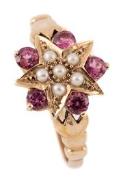 Sale 9095 - Lot 382 - A 9CT GOLD VICTORIAN STYLE TOURMALINE AND PEARL RING; featuring a star set with a cluster of seed pearls with a surround of 5 pink t...